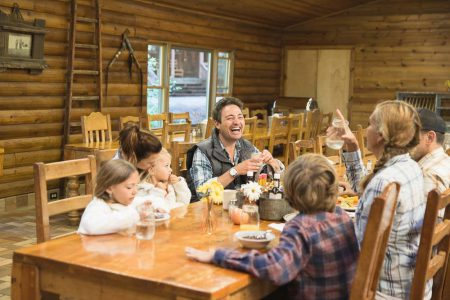 A family having fun around a dining table at Greenhorn Ranch in California