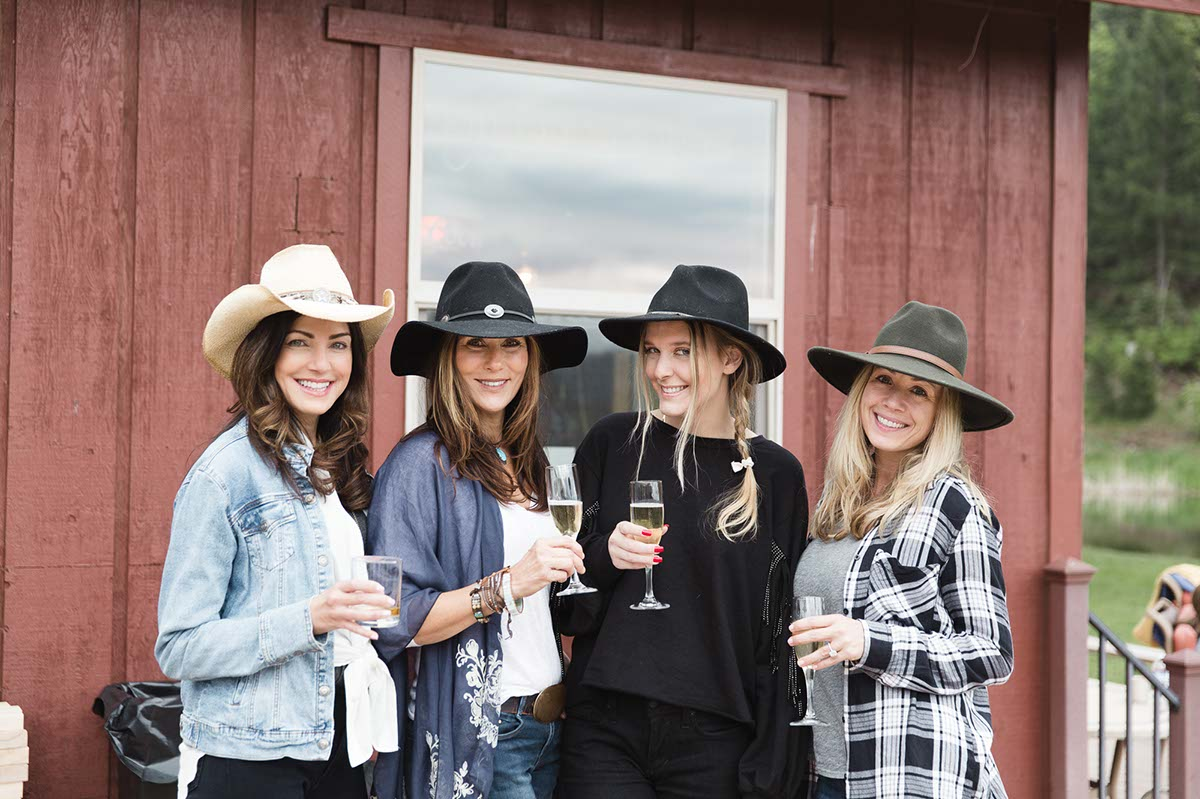 A group of women celebrating during a dude ranch vacation at Greenhorn Ranch