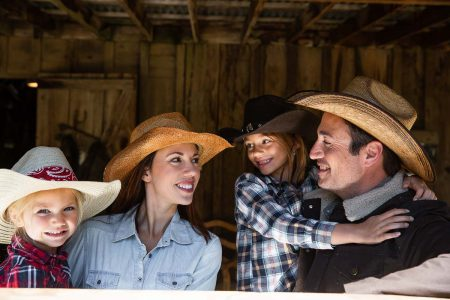 A family dressed in western attire at Greenhorn Ranch in California