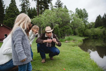 A family fishing at the lake at the Greenhorn Ranch in Quincy, CA