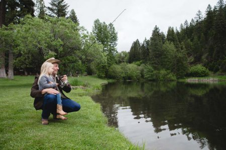 A father & daughter fishing at the lake at the Greenhorn Ranch in Quincy, CA