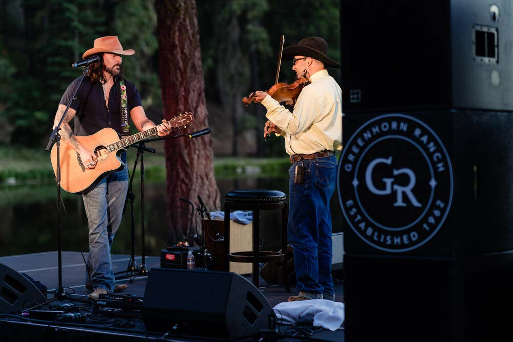 Always. guitarist and Always. fiddler playing together at a concert at Greenhorn Ranch