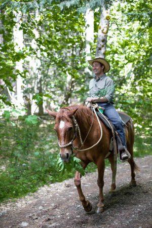 Horseback riding through the woods at Greenhorn Ranch