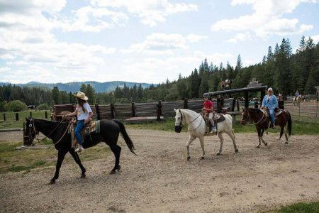 A horseback trail ride leaving the corral at Greenhorn