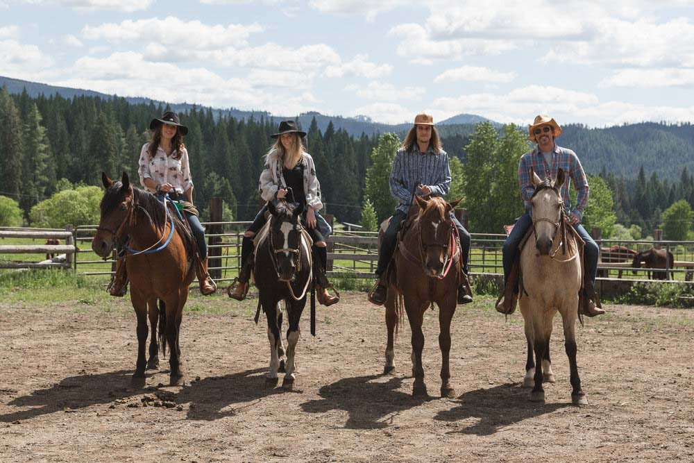 4 riders mounted on horses at Greenhorn Ranch in Quincy California