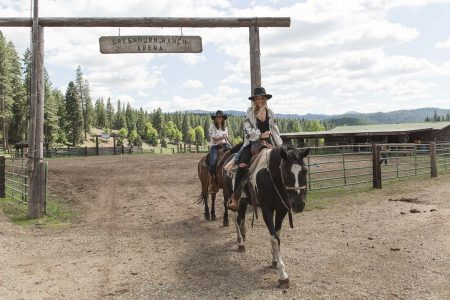 Two ladies on horseback leaving the corral at Greenhorn Ranch