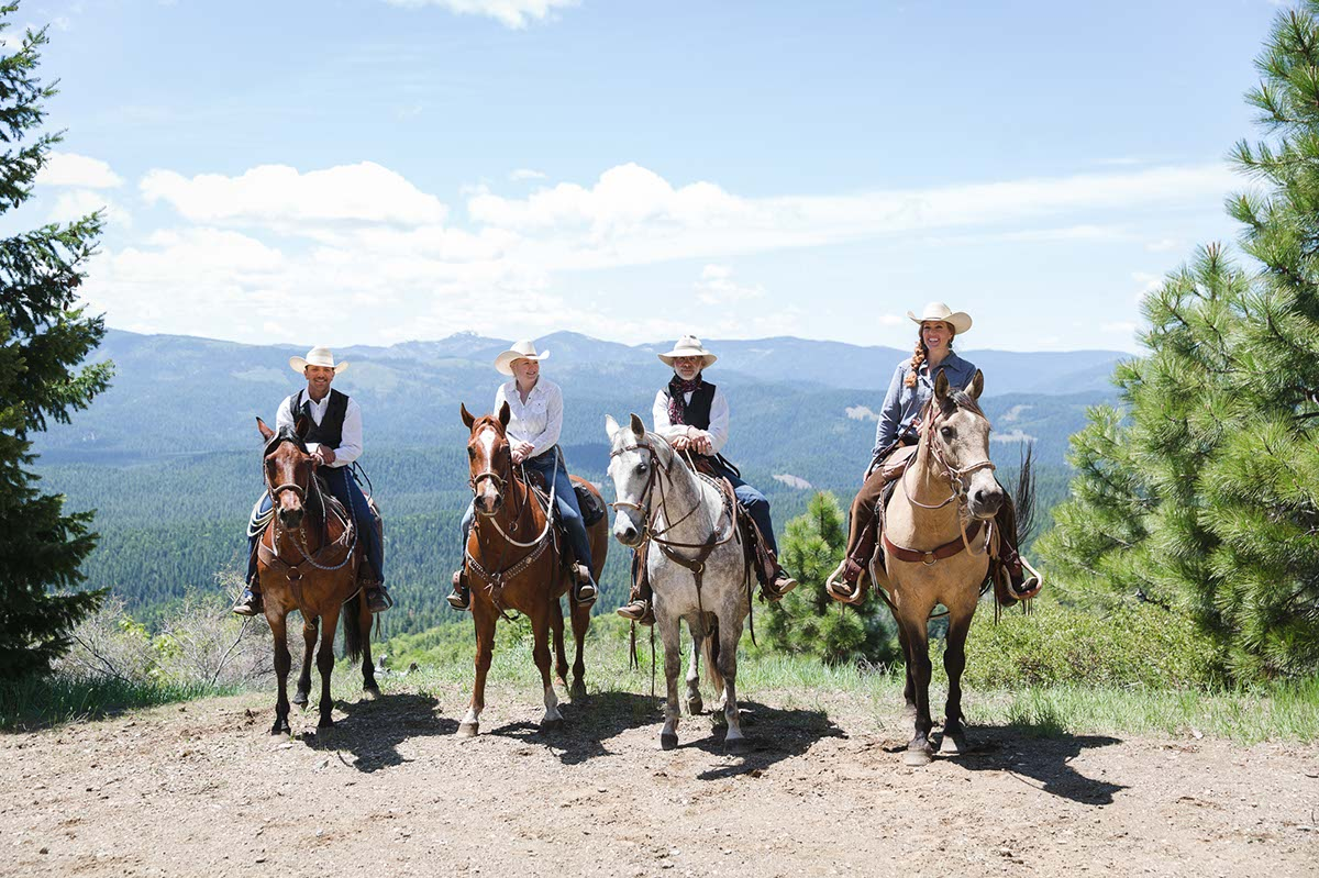 4 riders mounted on horses at Greenhorn Ranch