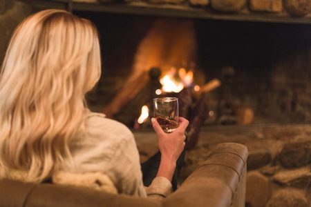 Enjoying a whiskey in front of the fireplace at Greenhorn Ranch