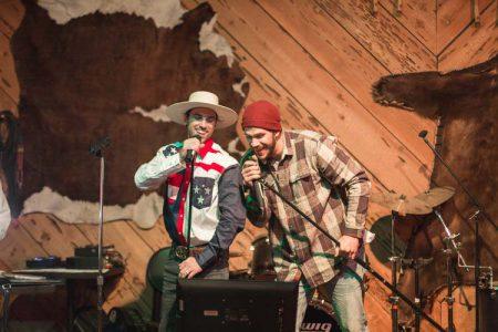 Singing Karaoke on stage in the Greenhorn saloon