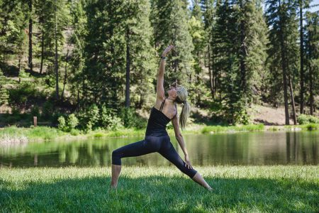 Practicing yoga outdoors by the lake at Greenhorn Ranch in California