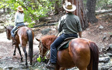 Horseback riders crossing a creek at Greenhorn Ranch