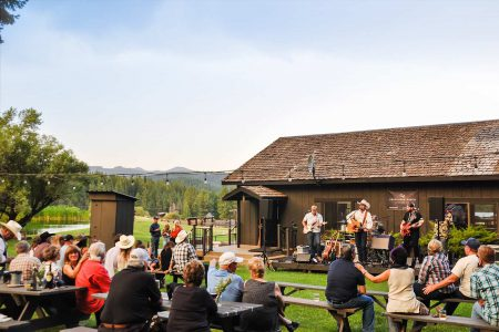 Live outdoor concert on a sunny afternoon at Greenhorn Ranch