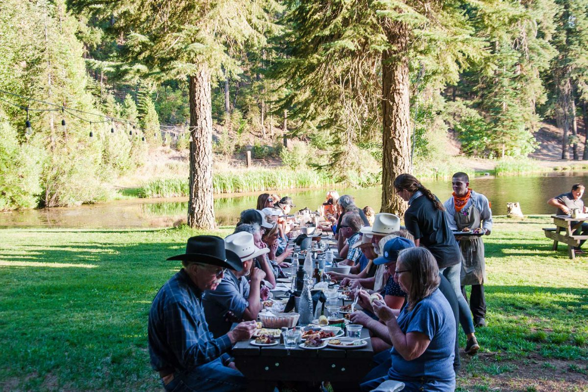 Outdoor dining by the lake at Greenhorn Ranch