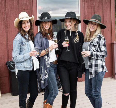 A group of four friends toasting their cocktails at Greenhorn Ranch