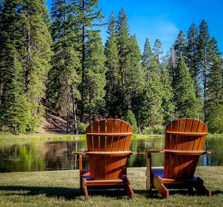 2 Adirondack chairs overlooking the lake at Greenhorn Ranch