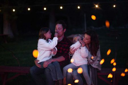 A family enjoying a campfire at Greenhorn Ranch in California