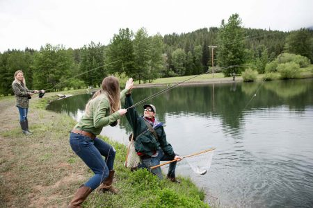High-five after catching a fish at the lake at Greenhorn Ranch