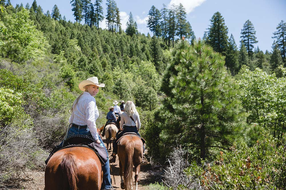 Riding horseback through the pine trees at Greenhorn Ranch in California