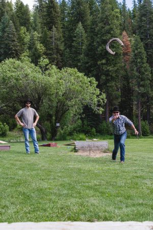 Playing horseshoes at the forest's edge