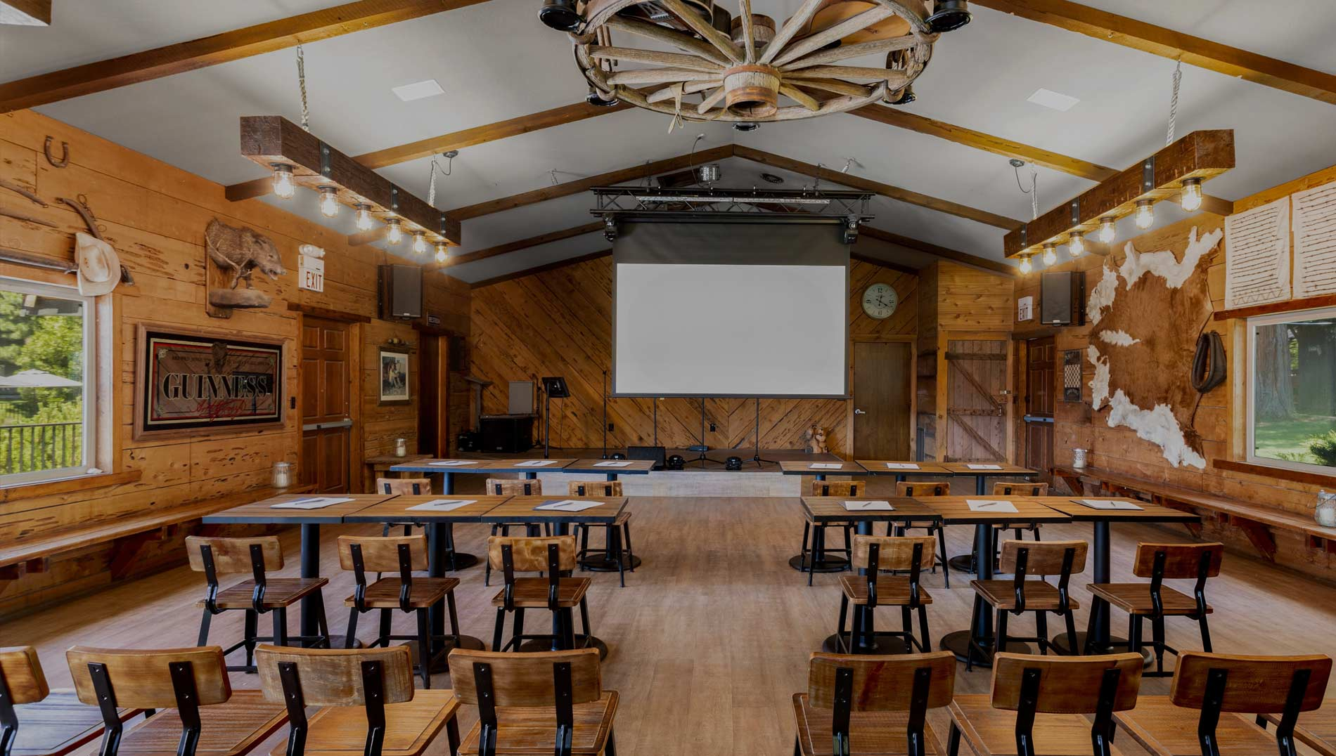 A meeting room with a screen up front at Greenhorn Ranch