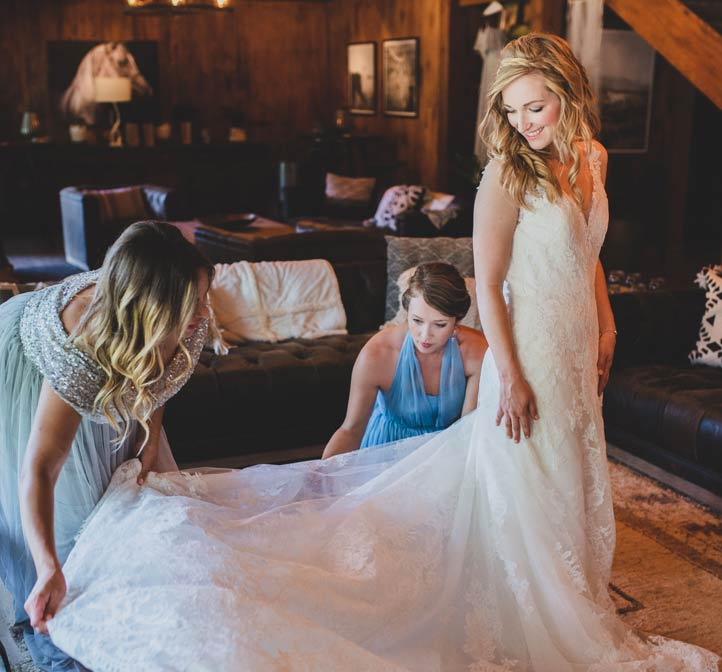 A bride in the dressing room preparing for her rustic wedding at Greenhorn Ranch