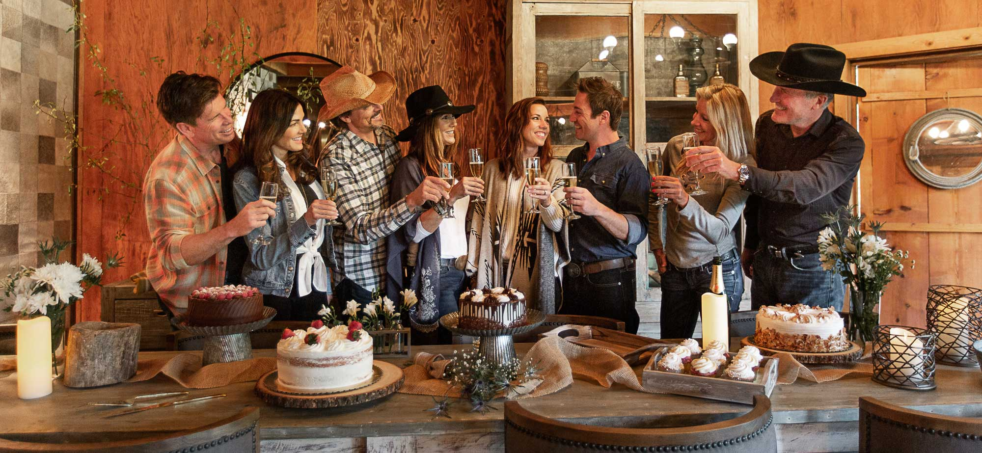 A group of people toasting cocktails at Greenhorn Ranch
