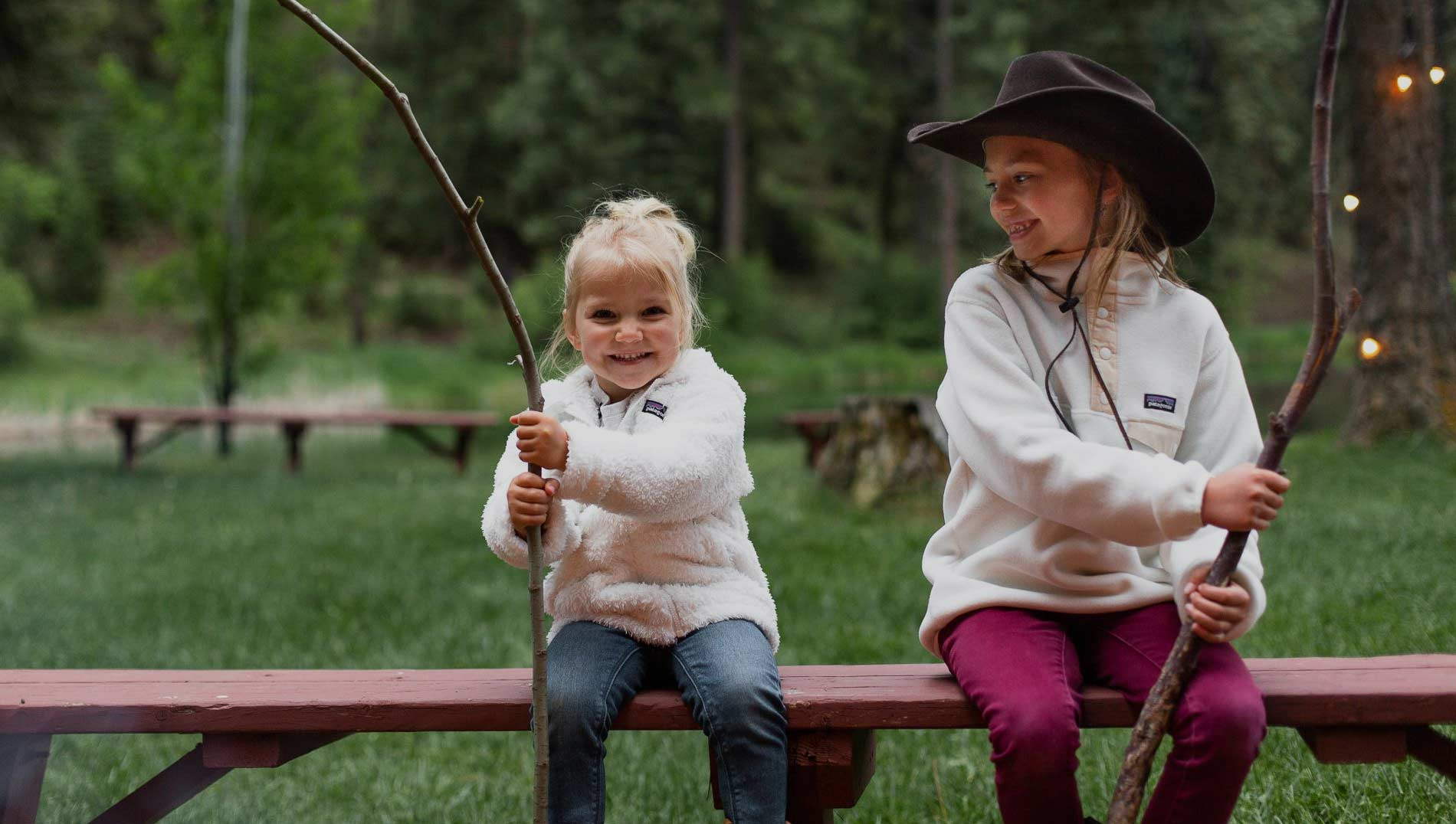Two young girls enjoying a campfire at Greenhorn Ranch in California