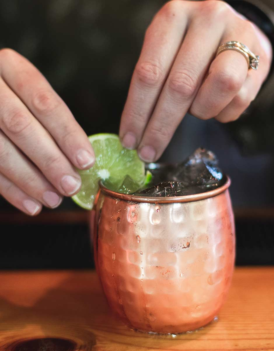Garnishing a copper-clad mule with lime