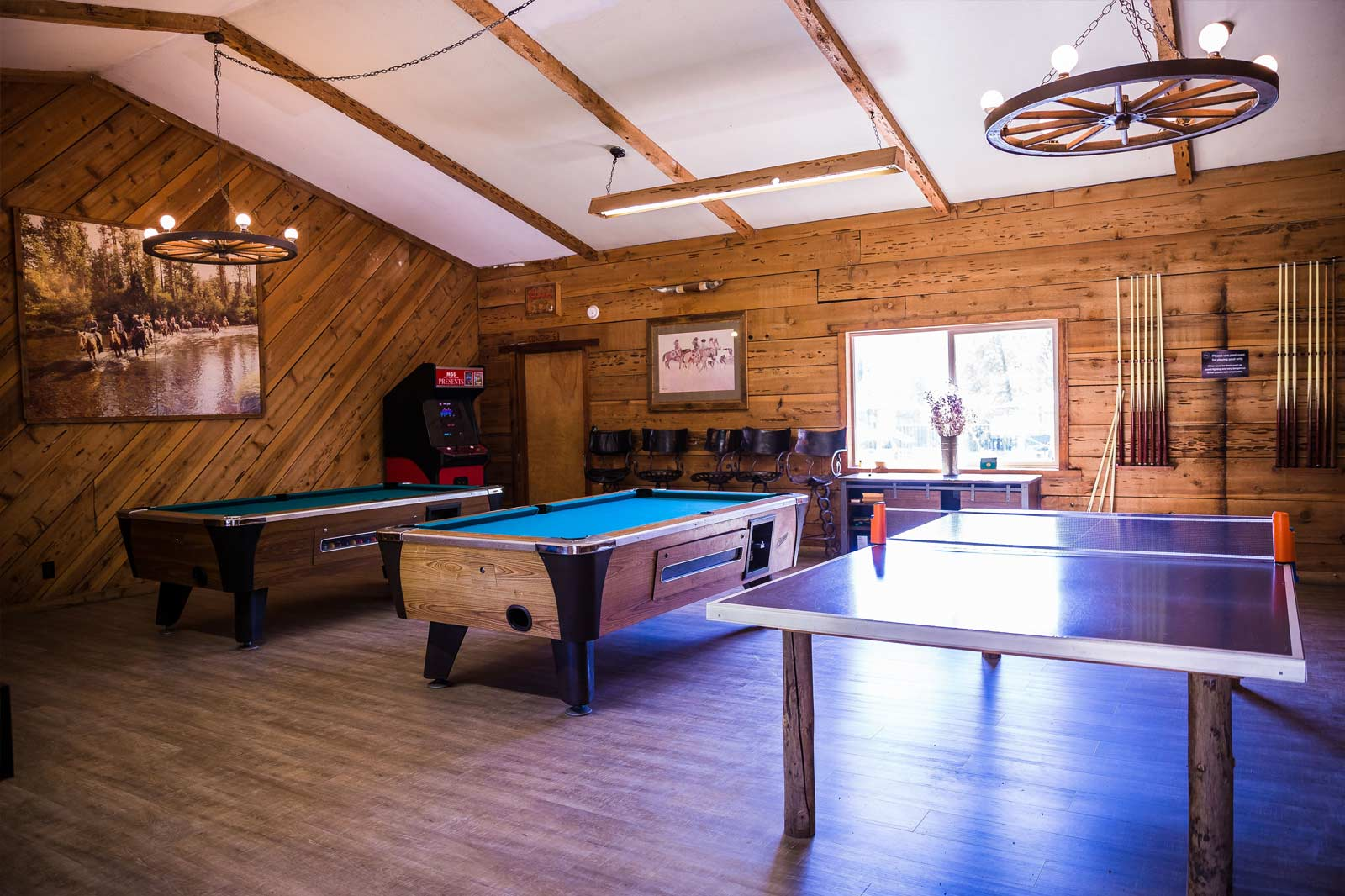 Pool tables and a ping pong table in the Saloon at Greenhorn Ranch