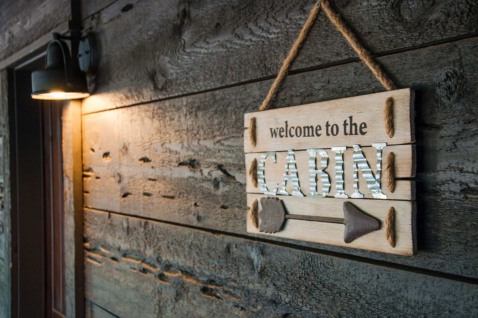 image of welcome to the cabin sign.
