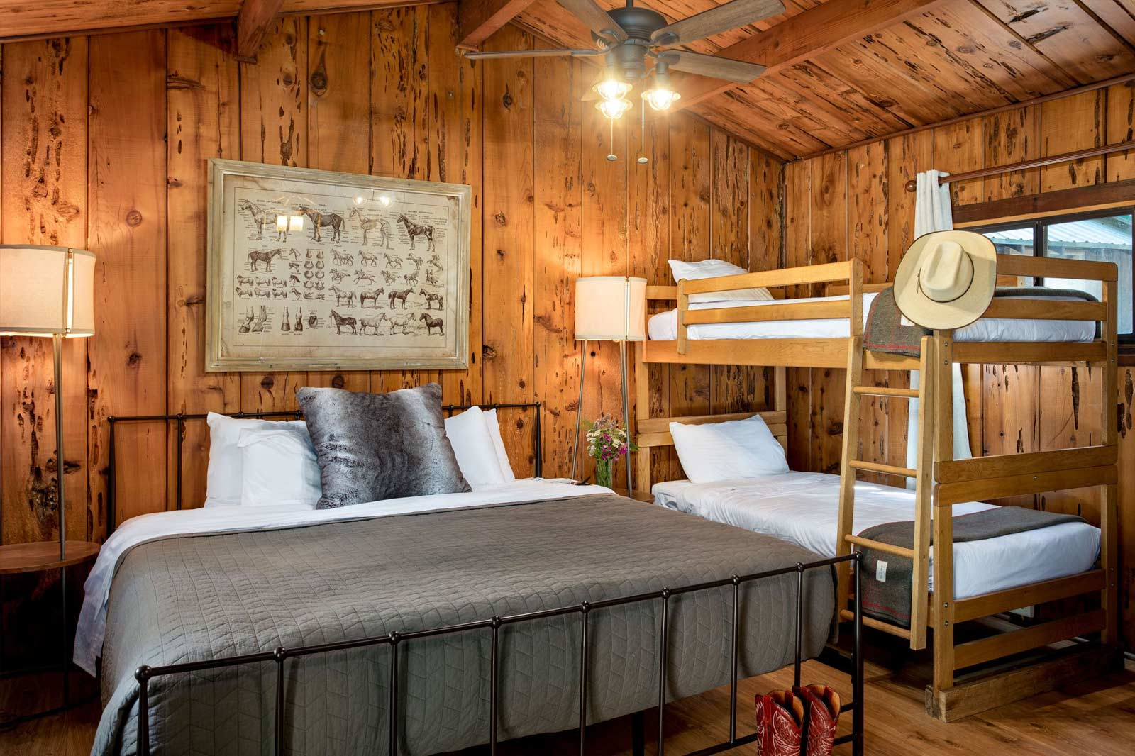 image of creekside bedroom with a king bed and a bunkbed with two twins.