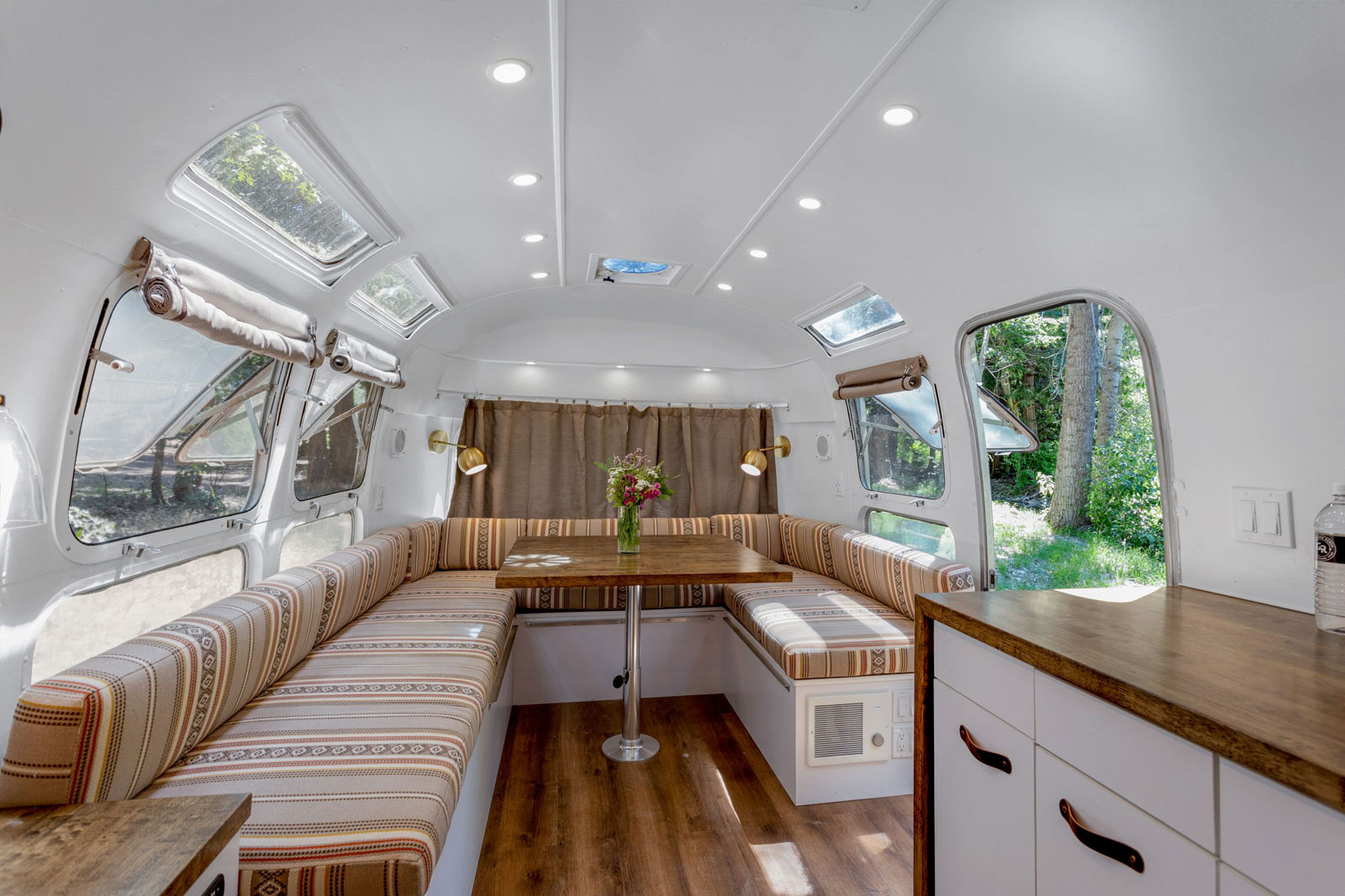 image of creekside airstream interior dining table and seating