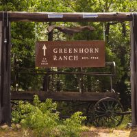 Hanging sign indicating that the Greenhorn Ranch is 1/4 mile away